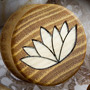 Osage orange plugs with ash wood lotus flower inlays
