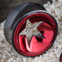 Black-coat plugs with red concave star cutout inlay