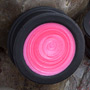 Pearl hot pink filled black silicone plug