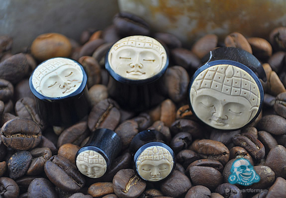 Black horn plugs with bone Buddha face inlays