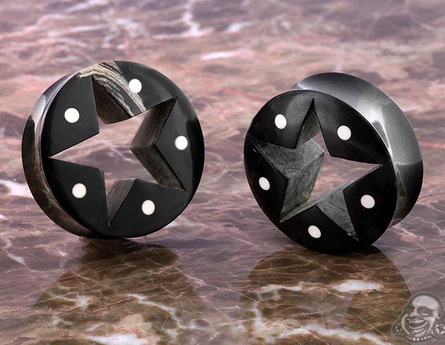 Diablo black horn star eyelets (pair)