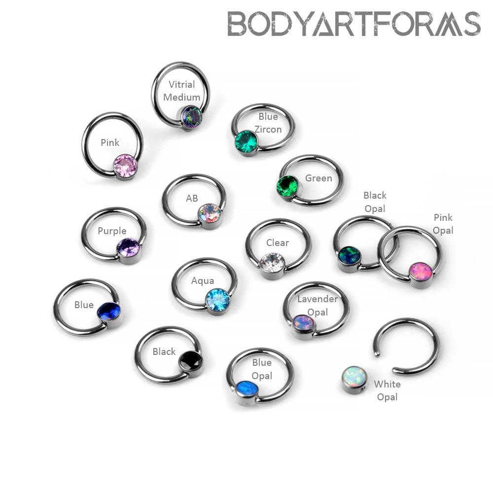 Titanium Captive Ring With A Bezel Set Bead
